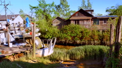 4K Beached Boat, Wetland Marsh Shanty Town, Springtime Stock Footage