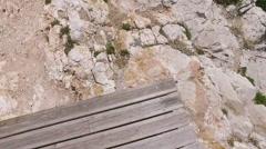 POV point of view Man Walking thru the rocks to the sea - stock footage