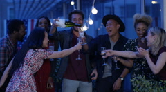 4K Happy group of friends celebrating with champagne at summer party Stock Footage