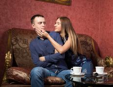 Problems in family relationships, a young couple sitting on the couch. man hurt Stock Photos