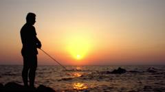 Fisherman fishing at sunset, silhouette , 4K ,3840 2160 Stock Footage