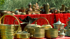 Old ethnic traditional copper dishes on the street market Stock Footage