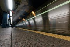 NEW YORK - USA - 13 JUNE 2015 - USA blur move effect on train in metro statio Kuvituskuvat