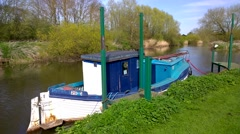 Boats moored in a small marina on the River Avon Stock Footage