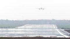 Jet passenger airplane landing in the summer heat Stock Footage