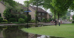 Extreme rain netherlands, people talking results, 4K Stock Footage