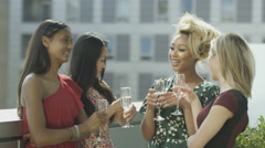 4K Beautiful female friends drinking & socializing on city rooftop - stock footage