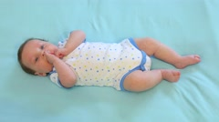 Newborn Child Relaxing In Bed - stock footage