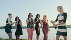 Summer holidays, vacation and celebration concept - smiling girls with champagne Stock Footage