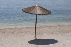 Beach Umbrella on the Seaside - stock photo