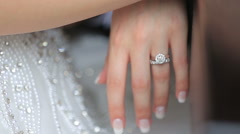 Happy bride and groom hands with golden wedding rings  close up. Tender moment - stock footage