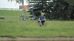 Man on bicycle and laptop riding from the park Stock Footage
