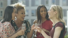 4K Beautiful female friends drinking & socializing on city rooftop Stock Footage