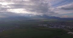 4K Aerial, Plain Field With View On High Tatra Mountain Range, Slovakia Stock Footage