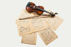 violin bow and notes - stock photo