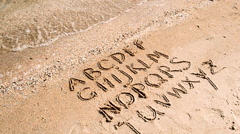 English alphabet written on a beach sand. Stock Footage