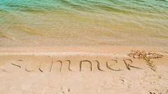 Inscription summer on sand, the beach. Stock Footage