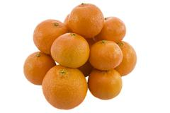 Heap of ripe fresh juicy tangerines isolated over white background - stock photo