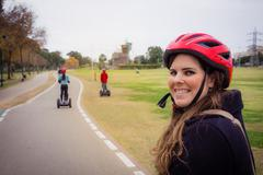 Group of people traveling on Segway in the park Stock Photos