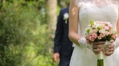 Handsome groom comes to bride behind her Stock Footage