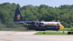 Blue Angels C 130 Fat Albert making a turn on the runway. - stock footage