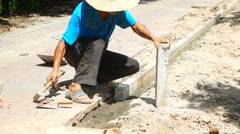 Chinese workers in road construction - stock footage