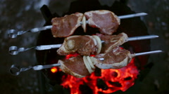 Cooking of pork shashlik on skewers on a wood stove in the winter Stock Footage