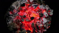 Close-up shot of smouldering embers in the furnace of the wood stove - stock footage