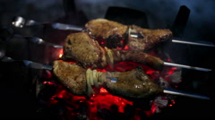 Cooking of pork shashlik on skewers on a wood stove in the winter - stock footage