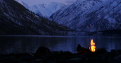 Camp Fire Near Mountain Lake Twilight Seamless Loop Stock Footage