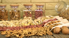 Salted pistachios in a glass jar, nut mix, selective focus Stock Footage