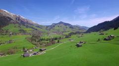 4K Mountain pasture aerial shot - stock footage