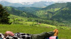 4K . Man tourist backpacker have rest in mountains hill. Focus change. Stock Footage