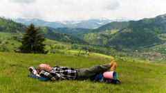 4K . Man tourist backpacker have rest sleeping in mountains hill.  Stock Footage
