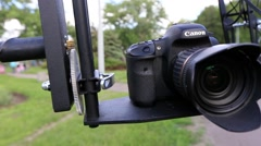 Photocamera turns on a camera crane Stock Footage