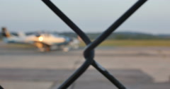 Single Engine Blue Plane at Airport Through Fence Dolly Shot, 4K Stock Footage