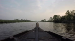 Bow of wooden boat on serene river Stock Footage