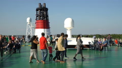 Рassengers walk on the upper deck of a large sea ferry - stock footage