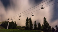 Fast moving clouds over the chairlift at night Stock Footage