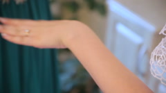 Bride in wedding dresses bracelet on the arm - stock footage