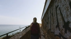 Tourist woman travels to mediterranean country at spring season. Girl walk the Stock Footage