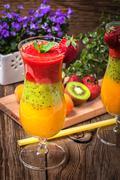 Smoothies with fresh fruit. Strawberries, apricots, kiwi. Stock Photos