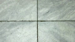 Cracks slowly appearing in marble floor - stock footage