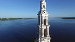 Old steeple sticking out in the middle of the river. Stock Footage