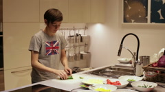Teenager Boy Cuts Cucumber Salads Stock Footage