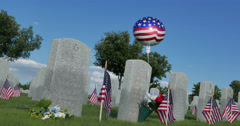 American Flag Decoration in the National Cemetery for Memorial Day Celebration - stock footage