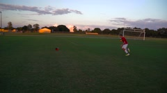 Soccer Player Kicks Soccer Ball Into a Goal - stock footage