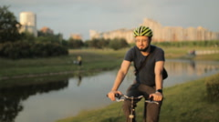 Man on folding bicycle with laptop computer Stock Footage