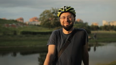 Happy male american cyclist with helmet Stock Footage