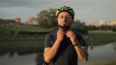 The man wears a bicycle helmet and removes it Stock Footage